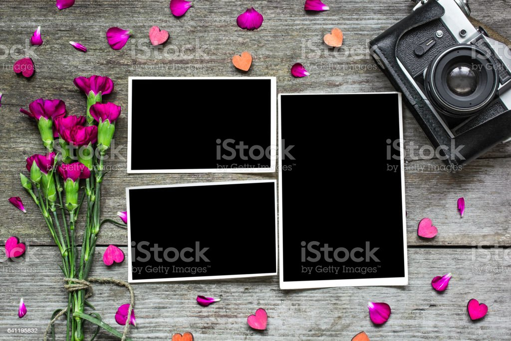 blank photo frames with vintage retro camera and purple flowers stock photo