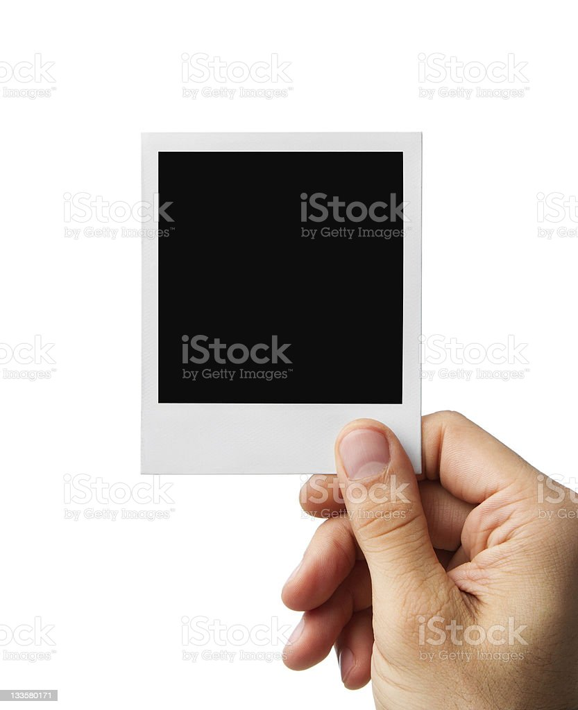 Blank photo in human hand with clipping path royalty-free stock photo