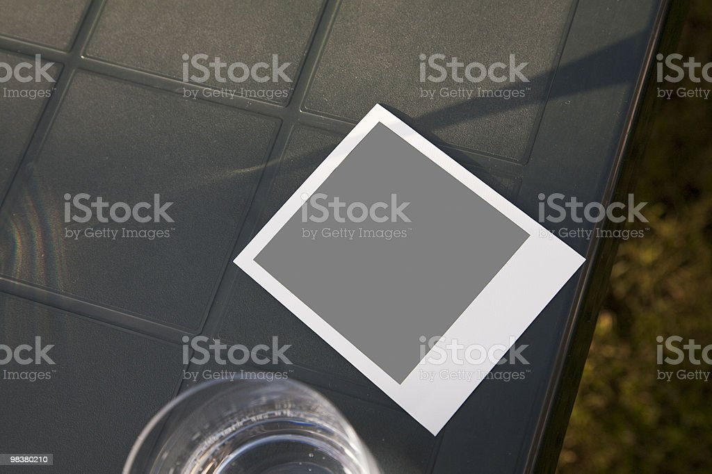 Blank photo on table in garden royalty-free stock photo