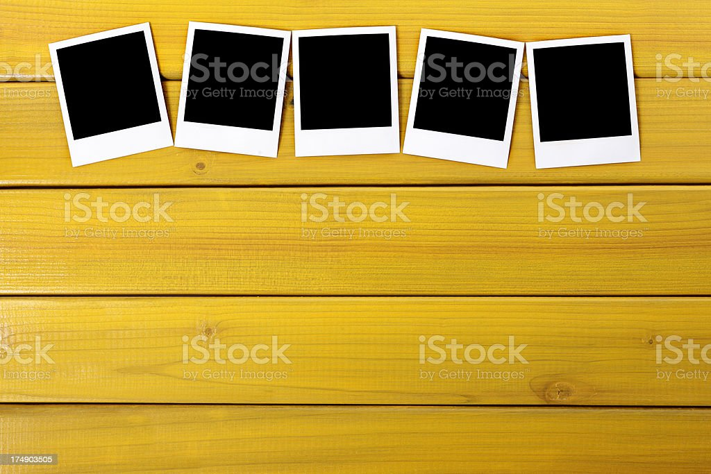 Blank photo prints on a table royalty-free stock photo