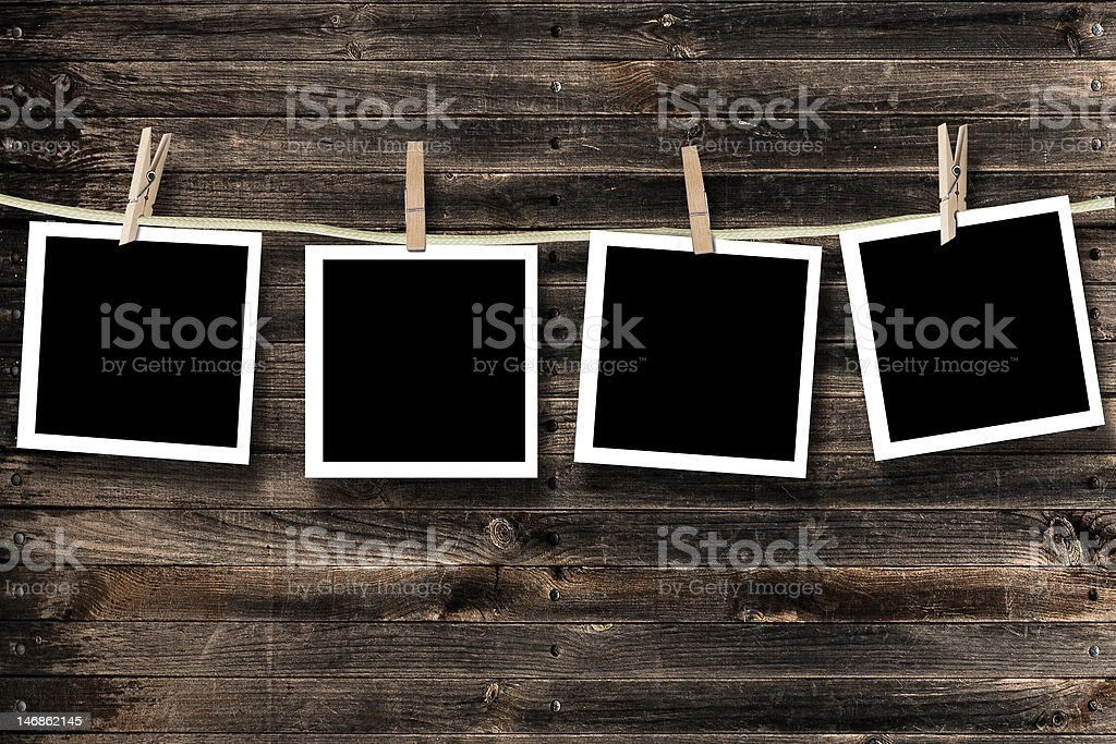 Blank photographs hanging on a clothesline royalty-free stock photo