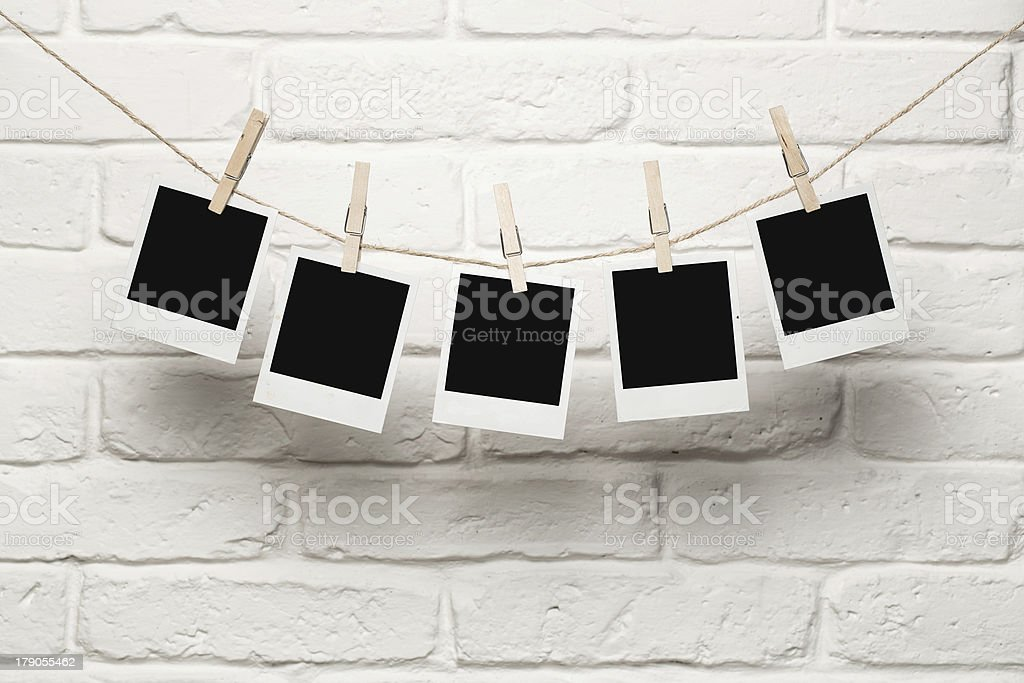 Blank photos hanging on a clothesline stock photo
