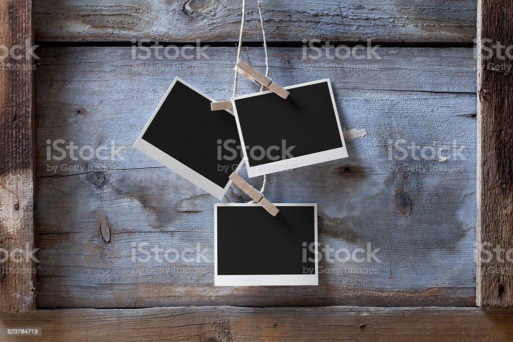 Blank photos hanging