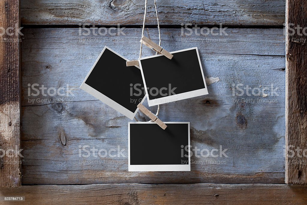 Blank photos hanging stock photo