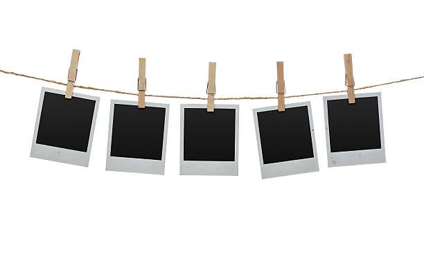 Blank photos on the clothesline stock photo