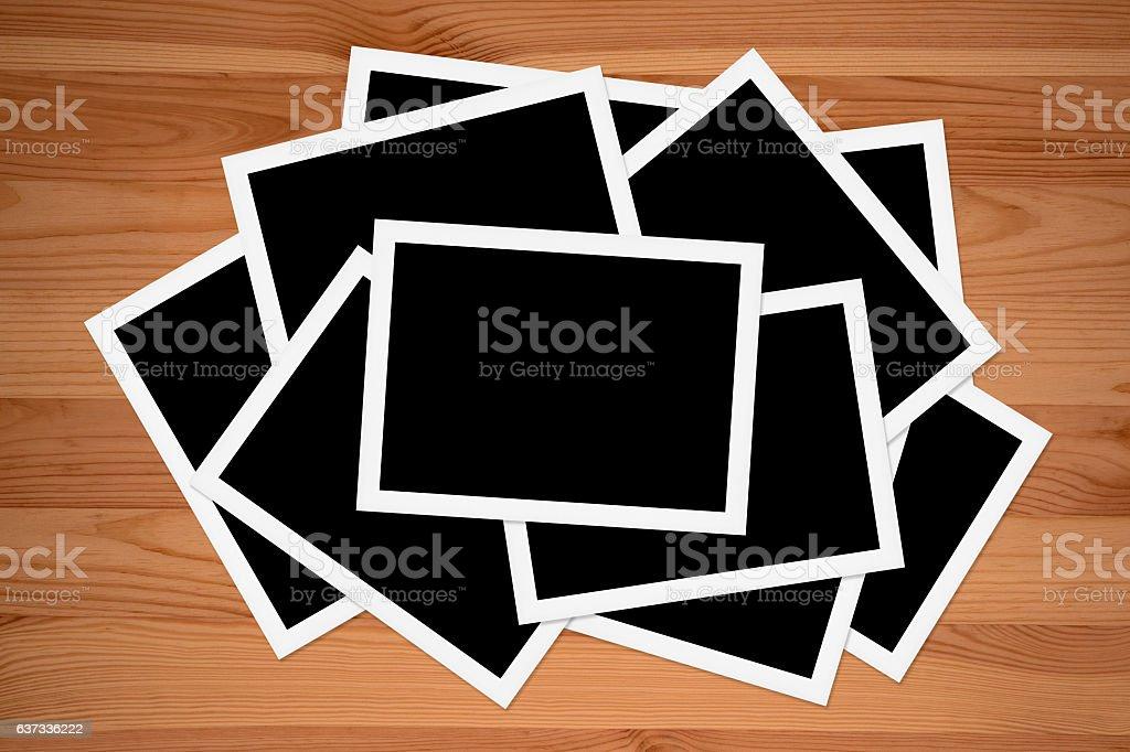 Blank photos on Wooden table stock photo
