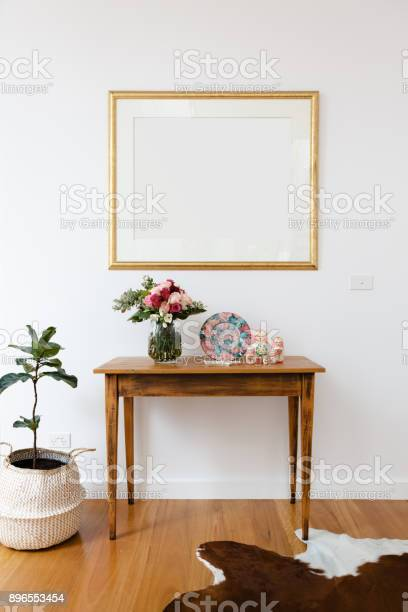Blank picture frame above a side table with flowers and pot plant picture id896553454?b=1&k=6&m=896553454&s=612x612&h=zwrb peifhmedqskkfddk4kyna1qiqjyn85ecebq2pm=