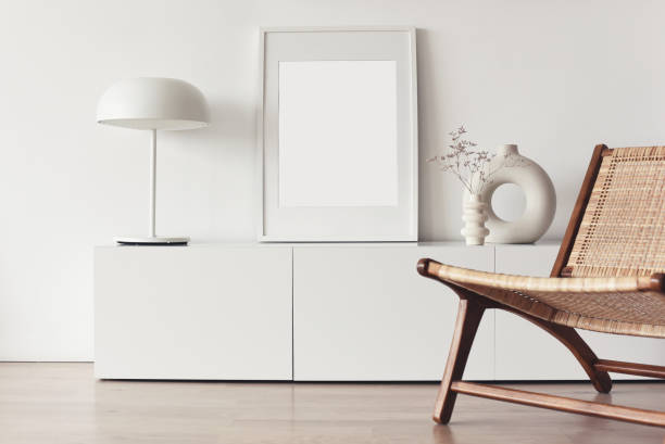 Blank picture frame mockup on white wall. Living room design stock photo