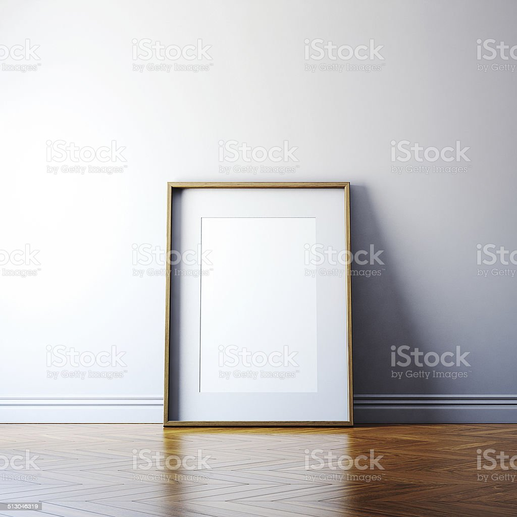 Blank picture frame on a wall stock photo