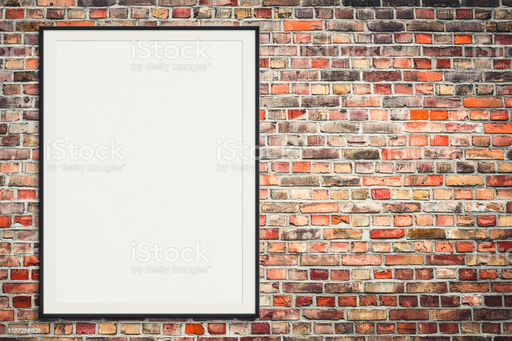 blank picture frame on brick wall with copy space - framed poster...