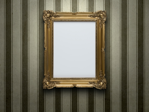 Blank gold picture frame at grunge striped wall with copy space