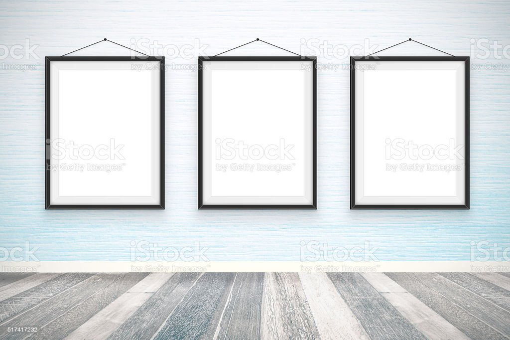 Blank picture frames on the wooden wall room stock photo