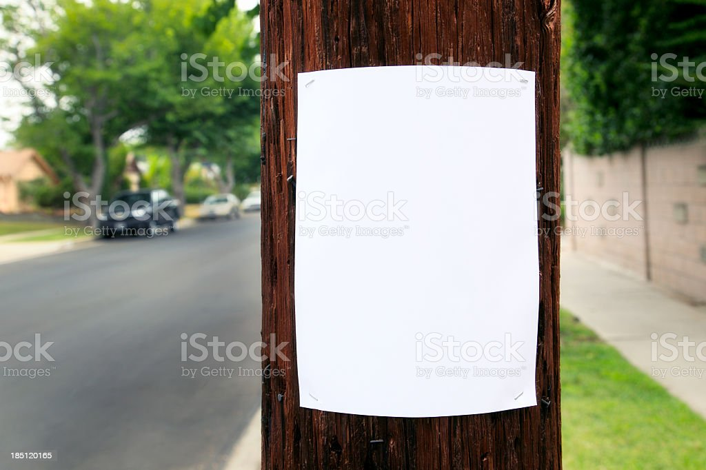 Blank piece of paper hanging on the telephone pole  stock photo