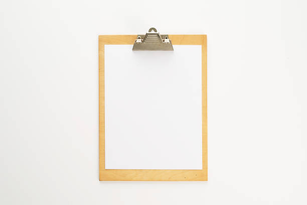 Blank piece of paper on a clipboard stock photo