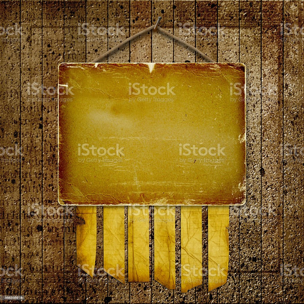 blank piece of wood hanging from nail on abstract background royalty-free stock photo