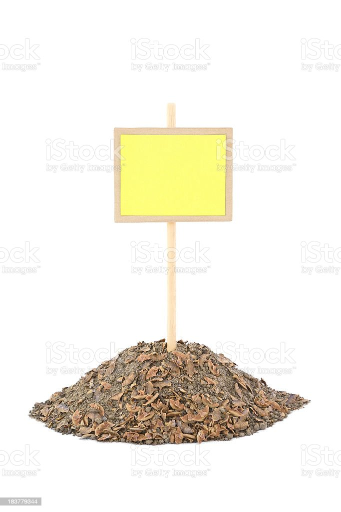 Blank placard on a molehill, isolated on white stock photo