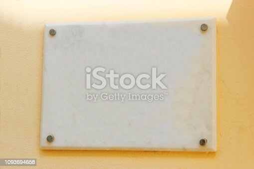 924754302 istock photo Blank plaque on yellow wall. 1093694658