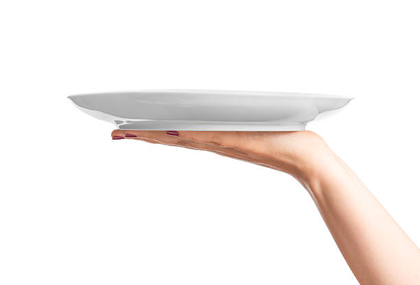 Blank plate on hand stock photo