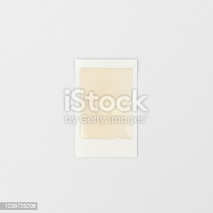 144325206 istock photo blank polaroid photo frame isolated on white background 1239725208