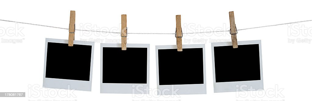 Blank Polaroid photographs hanging on a line stock photo