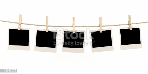 Several blank instant photo prints hanging on a rope or washing line.   Alternative version of this file shown below: