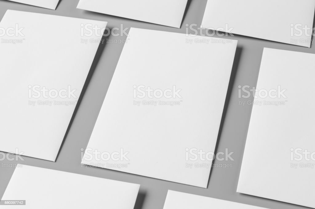 Blank portrait A4. brochure magazine isolated on gray, changeable background / white paper isolated on gray stock photo