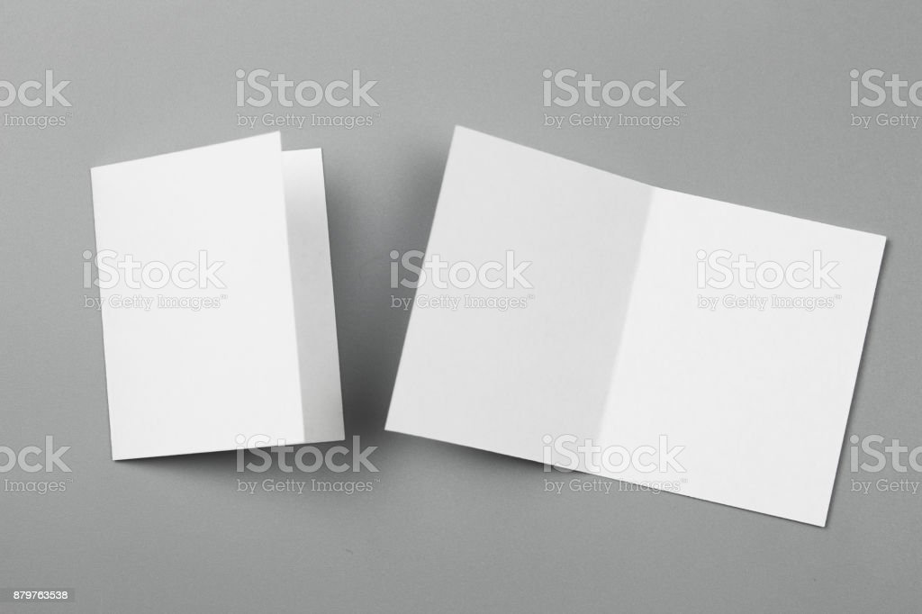 Blank portrait mock-up paper. brochure magazine isolated on gray, changeable background / white paper isolated on gray stock photo