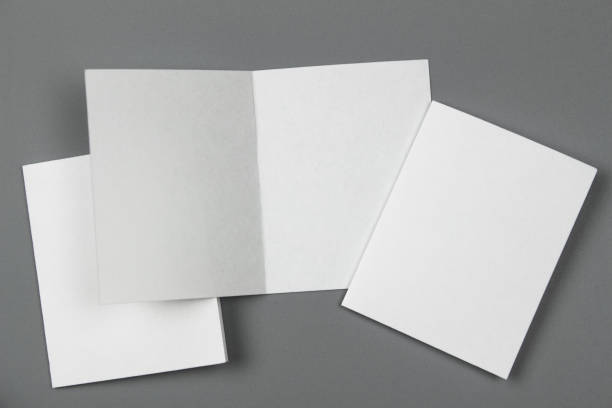 blank portrait mock-up paper. brochure magazine isolated on gray, changeable background / white paper isolated on gray - postcard template stock photos and pictures