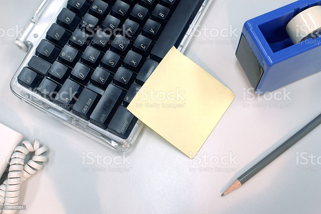 blank post it note on keyboard royalty-free stock photo