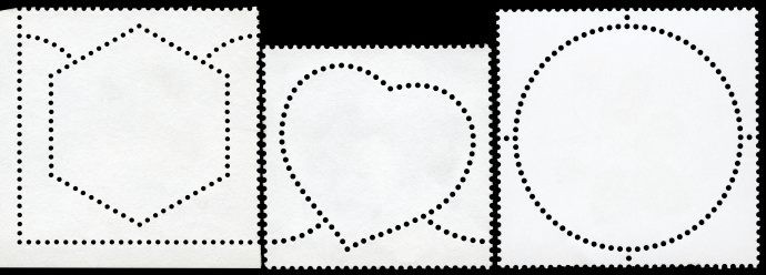 The reverse side of stamps of different shapes. Isolated On Black.