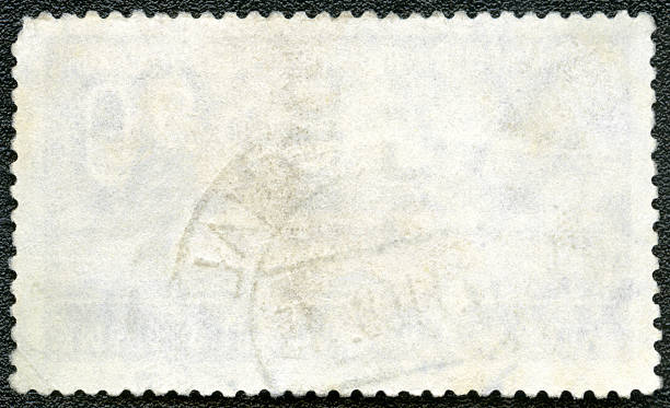blank postage stamp on a black background - rubber stamp texture stock photos and pictures