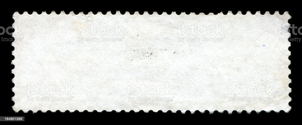 Blank postage stamp textured isolated on black background stock photo