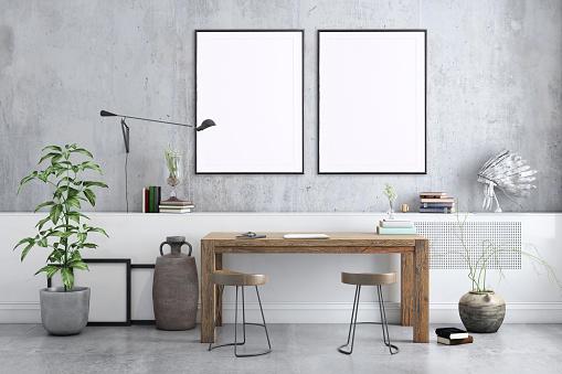 Freelancer home studio interior. Wooden desk. Blank picture poster frame. Artist designer background template.