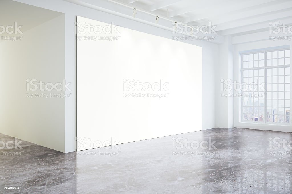 Blank poster in light modern loft gallery with big windows stock photo