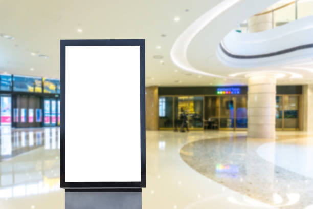 blank poster in shopping mall - shopping mall stock photos and pictures
