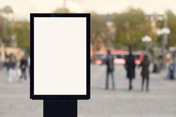 Blank poster on a city square stock photo