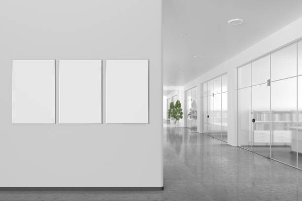 Blank poster on the wall in modern office interior stock photo