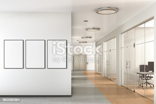 istock Blank poster on the wall in modern office 992085364