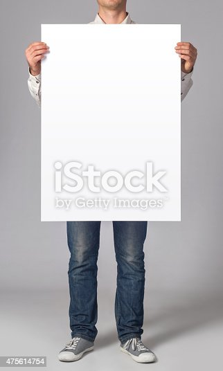 Man holding a blank poster