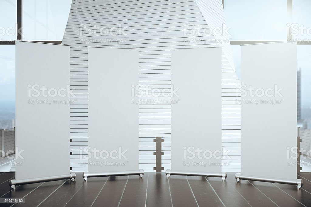 Blank posters on wooden floor in futuristic interior hall stock photo