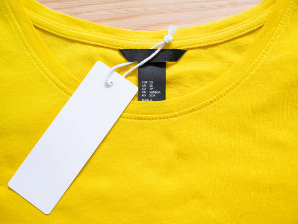 Blank price tag label Blank price tag label on yellow t-shirt labeling stock pictures, royalty-free photos & images