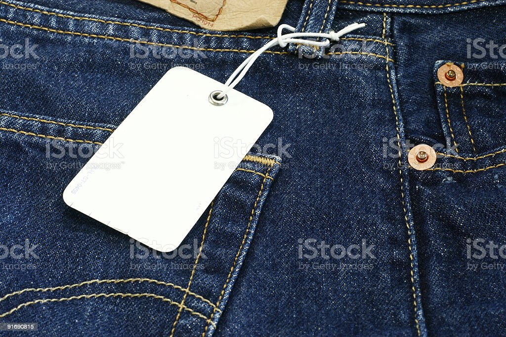 Blank price tag on Blue Jeans royalty-free stock photo