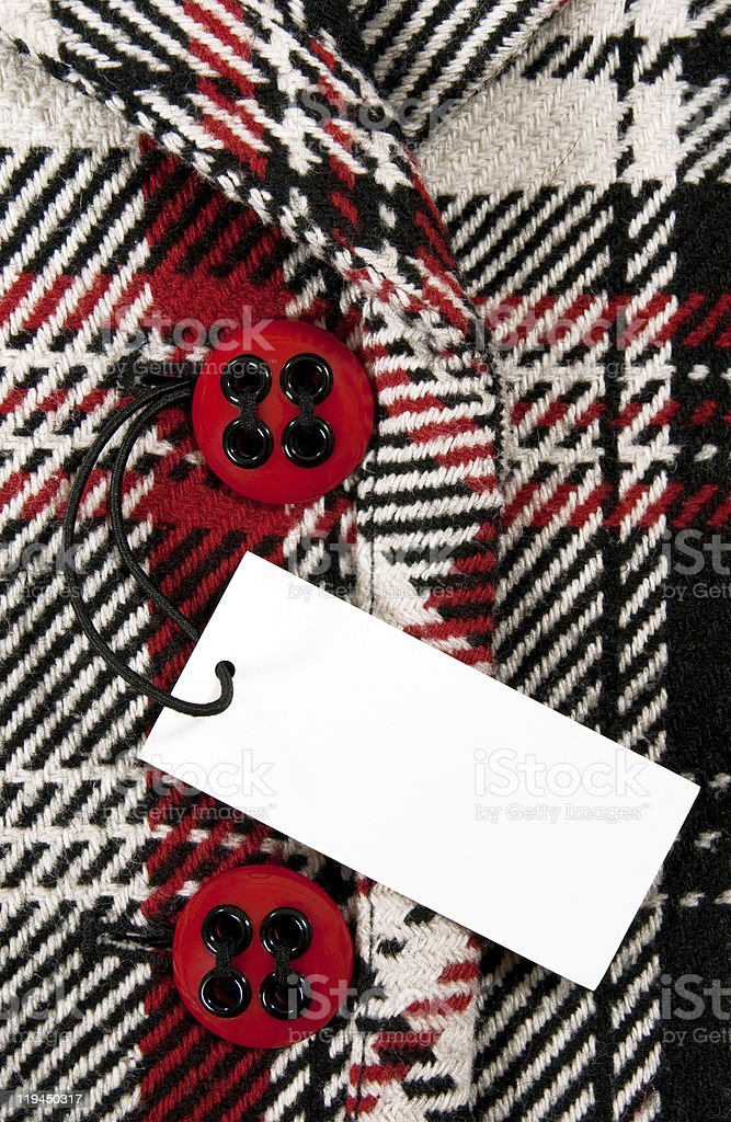 Blank price tag on checked coat with red buttons royalty-free stock photo