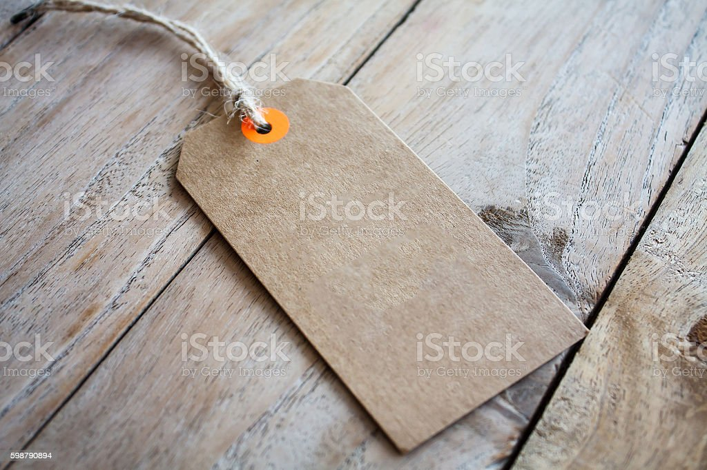 Blank price tag on wood background stock photo