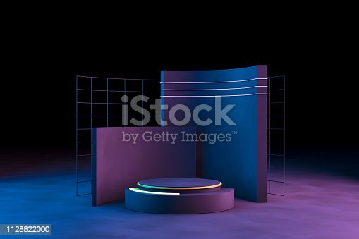 istock Blank product stand with neon lights on dark background 1128822000