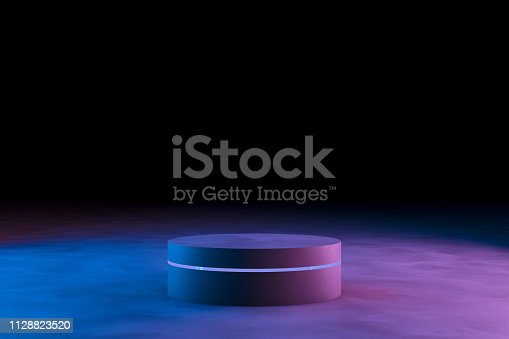 istock Blank product stand with neon lights on dark background 1128823520