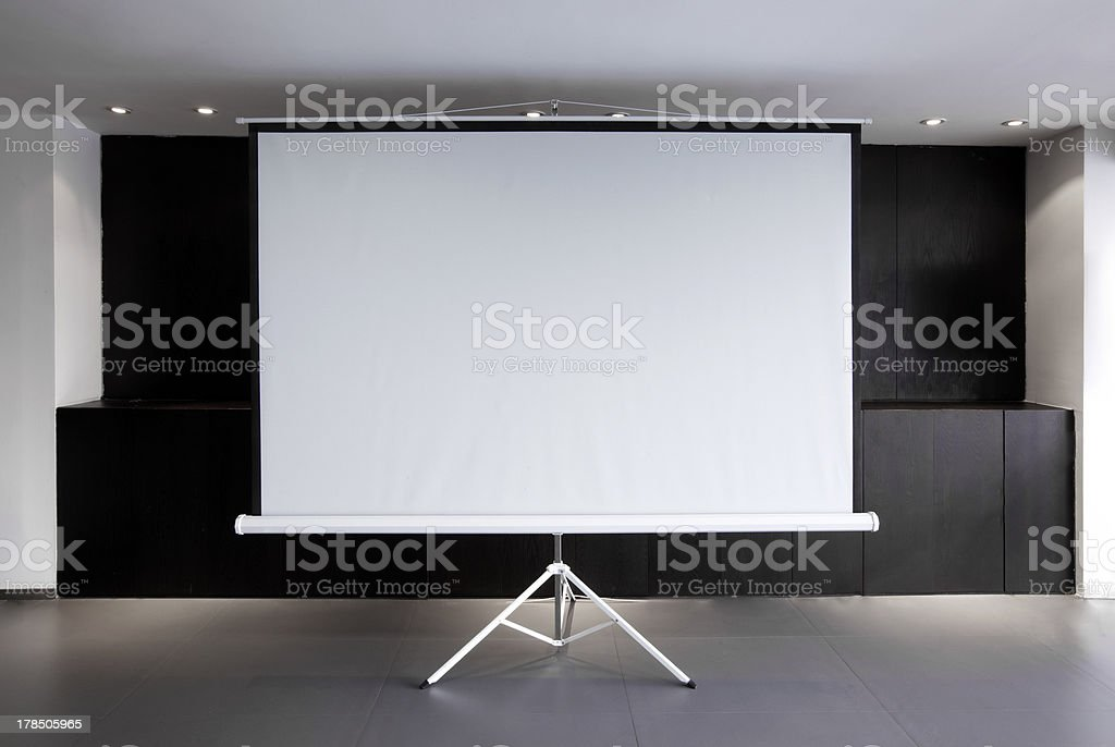 Blank projector canvas in the office stock photo