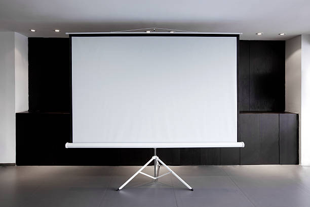 blank projector canvas in the office - projection screen stock photos and pictures