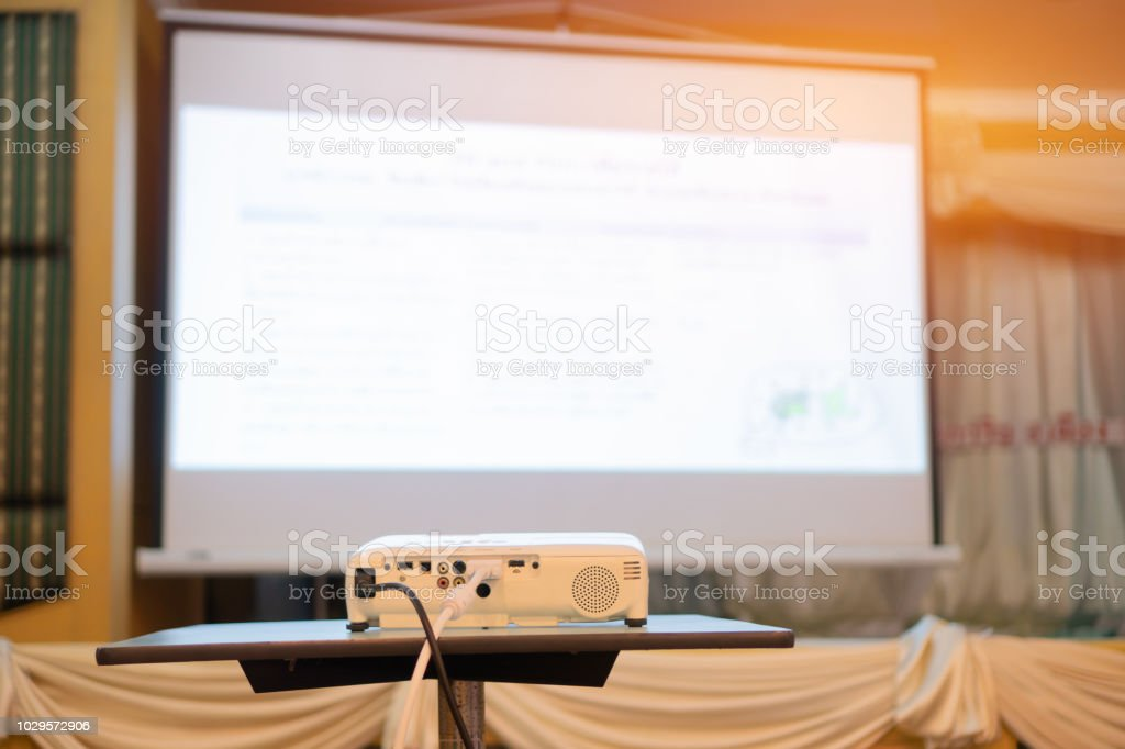 Blank projector with white screen for presentation in conference or...