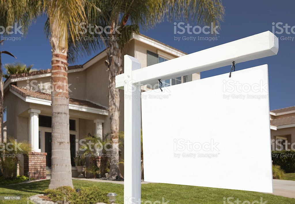 Blank Real Estate Sign and Home royalty-free stock photo